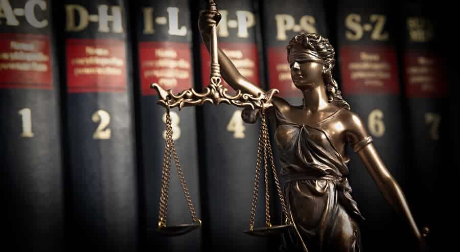 bigstock Statue Of Justice On Books Bac 279348400 Top Trust Litigation Attorney Serving Orange County, CA.